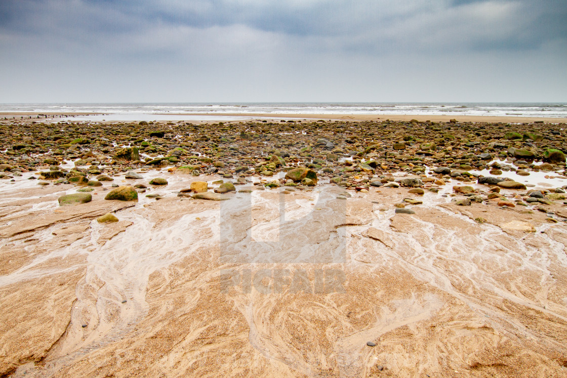 """""""Sandsend, Yorkshire, England. Looking across the beach towards the North Sea."""" stock image"""