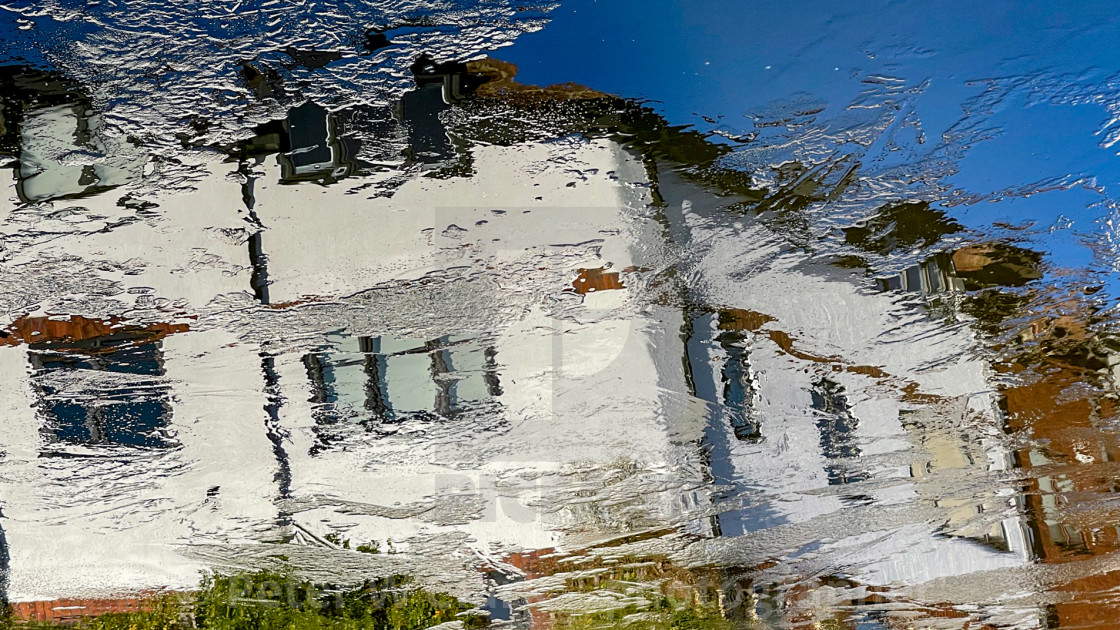 """A Colourful Reflection on an icy Leeds Liverpool Canal at Silsden (Cobbydale)"" stock image"
