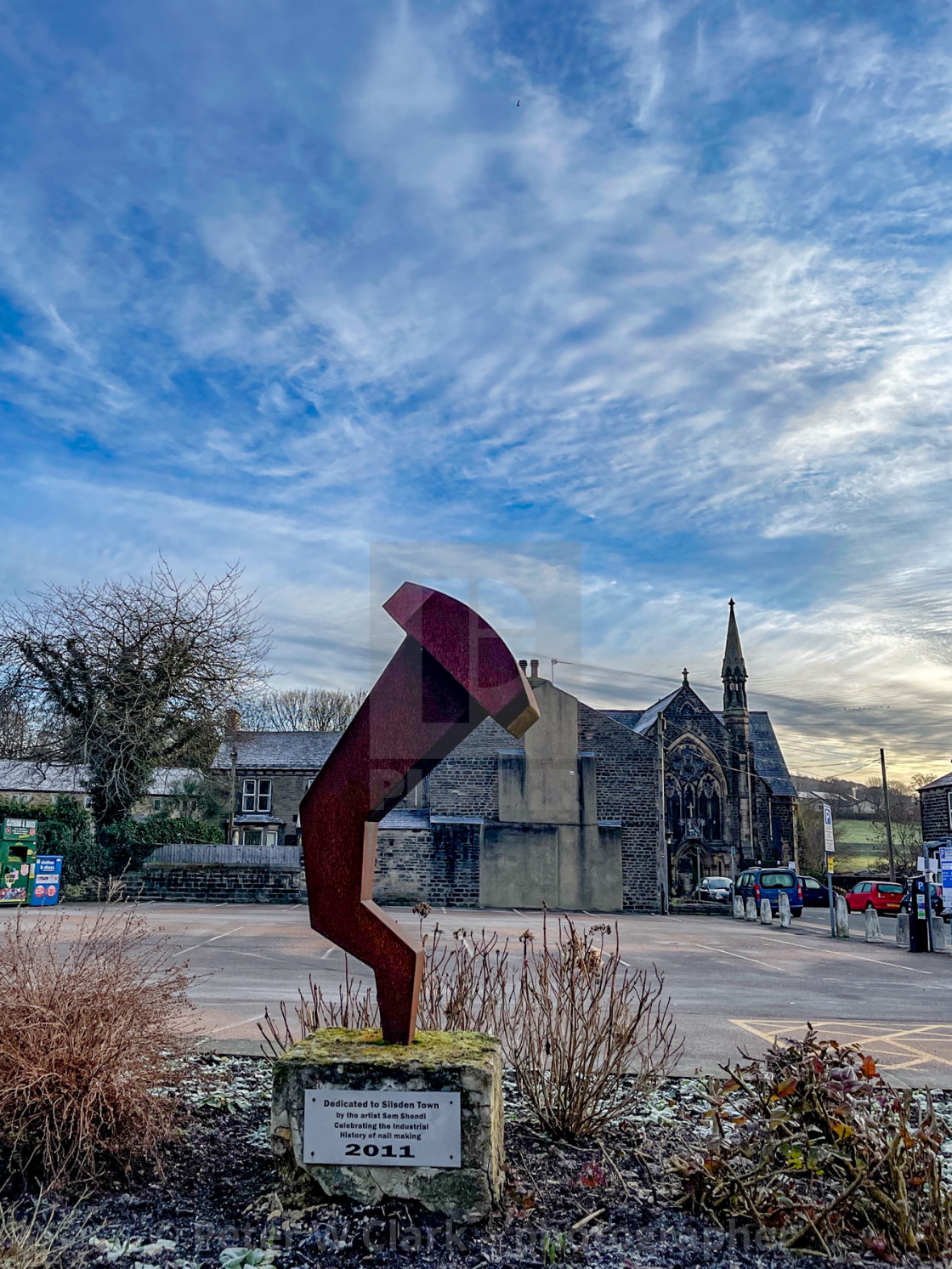 """Sculpture on plinth Dedicated to Silsden Town by the artist Sam Shendi, celebrating the Industrial History of Nail Making."" stock image"