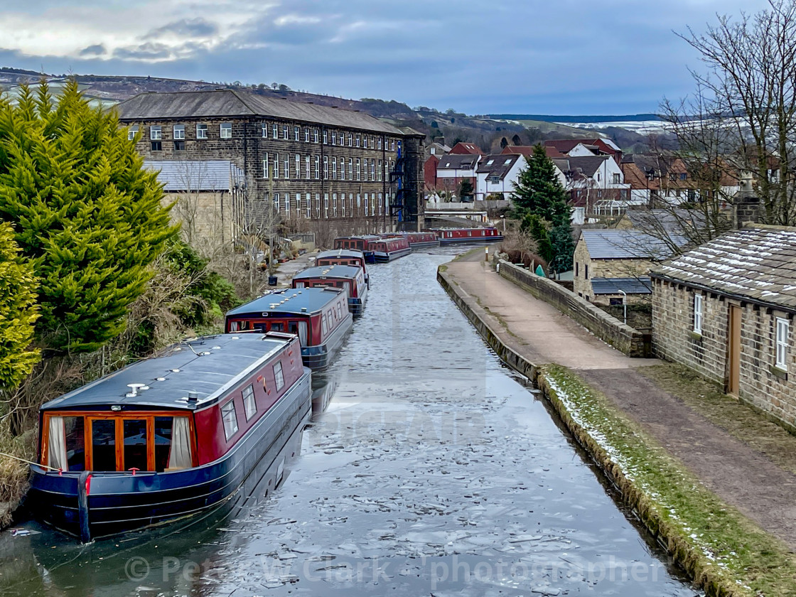 """Holiday Narrowboat/Barge Moored on the Leeds and Liverpool Canal at Silsden (Cobbydale) Yorkshire, England, Photographed 14th February 2021. Industrial Mill in background."" stock image"