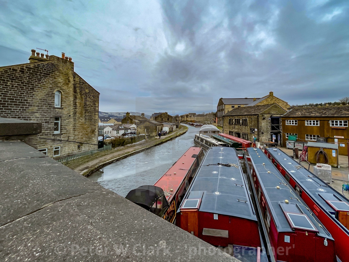 """Holiday Narrowboat/Barge Moored on the Leeds and Liverpool Canal at Silsden (Cobbydale) Yorkshire, England, Photographed 14th February 2021"" stock image"