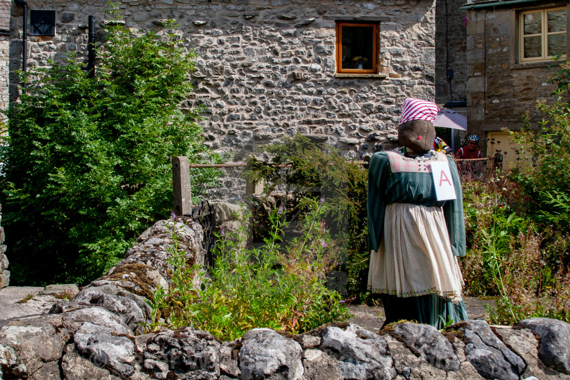 """Kettlewell Scarecrow Festival and Trail, Scarecrow in Garden. Yorkshire Dales, England."" stock image"
