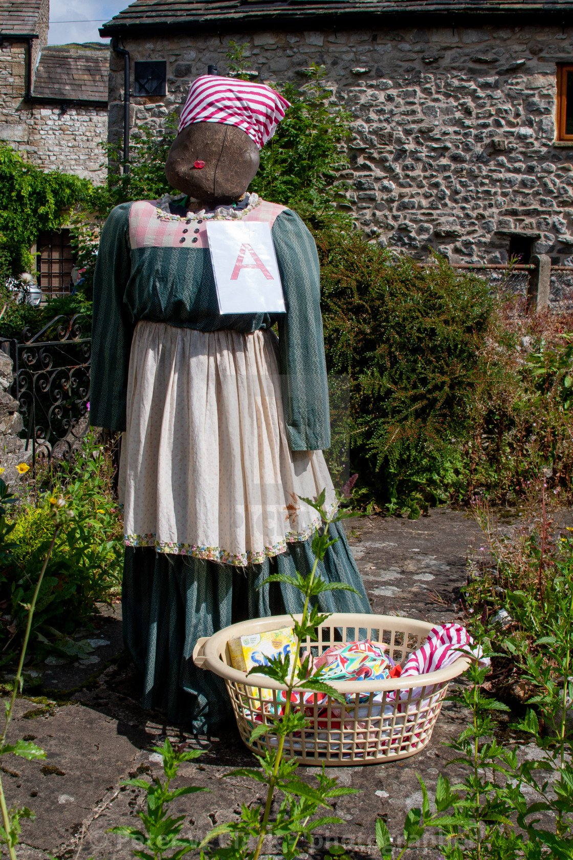 """Kettlewell Scarecrow Festival and Trail, Scarecrow with Washing. Yorkshire Dales, England."" stock image"