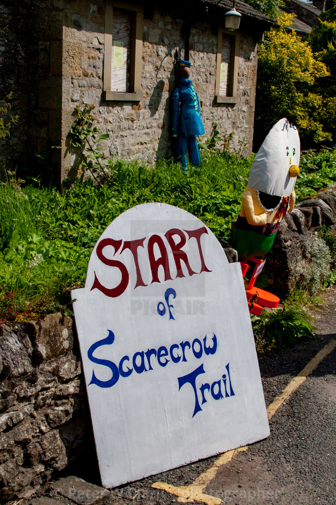 """Kettlewell Scarecrow Festival and Trail, Start Sign. Yorkshire Dales, England."" stock image"