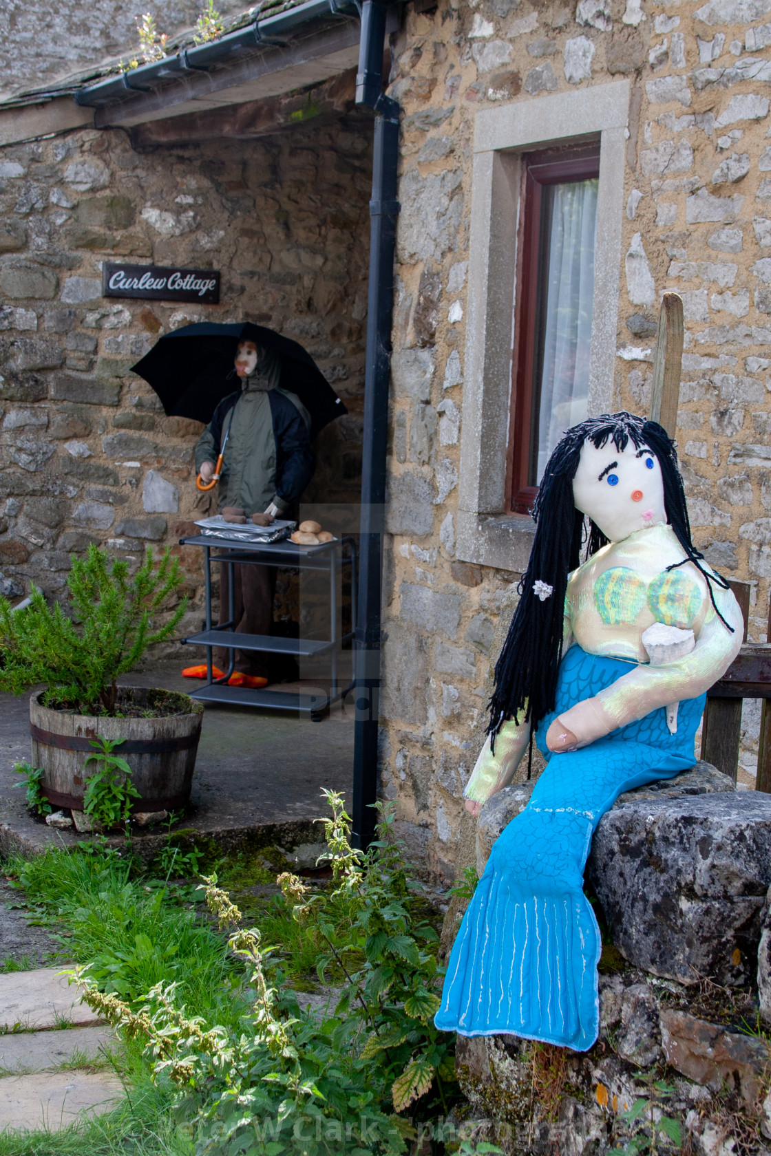 """Kettlewell Scarecrow Festival and Trail, Barbeque. Yorkshire Dales, England."" stock image"