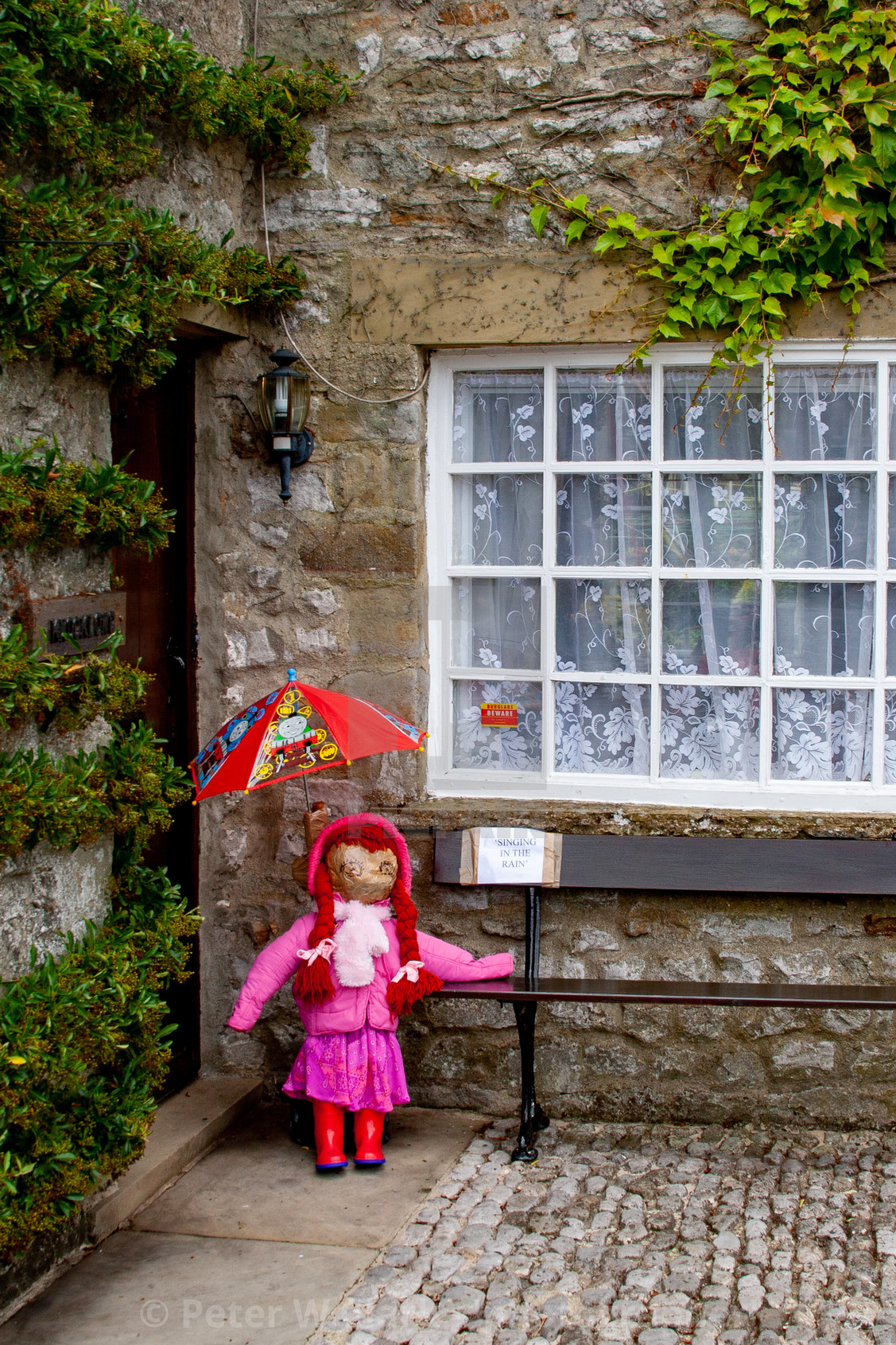 """Kettlewell Scarecrow Festival and Trail, Singing in the Rain. Yorkshire Dales, England."" stock image"