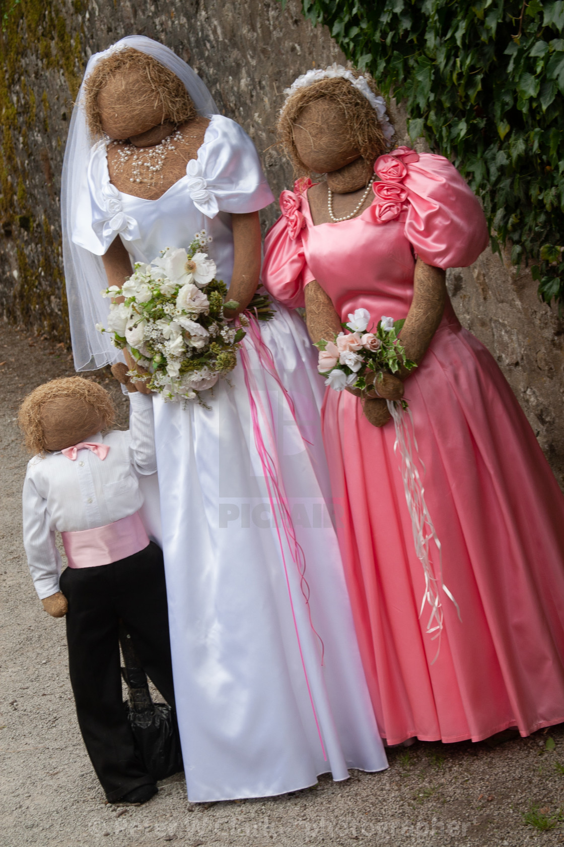 """Kettlewell Scarecrow Festival and Trail, Bride and Bridesmaid. Yorkshire Dales, England."" stock image"