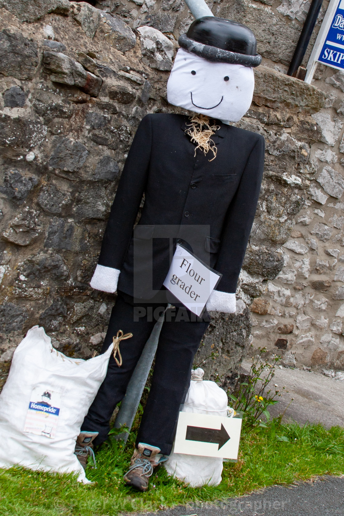"""Kettlewell Scarecrow Festival and Trail, Flour Grader. Yorkshire Dales, England."" stock image"