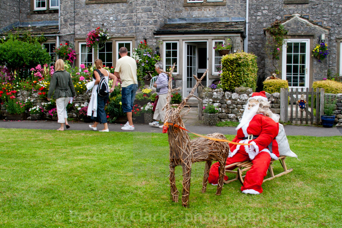 """Kettlewell Scarecrow Festival and Trail, Santa on Sleigh. Yorkshire Dales, England."" stock image"