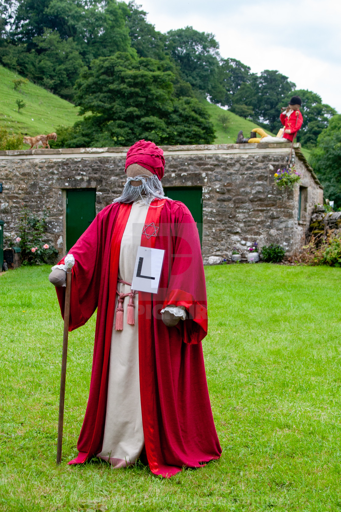 """Kettlewell Scarecrow Festival and Trail, Fox and Huntsman. Yorkshire Dales, England."" stock image"