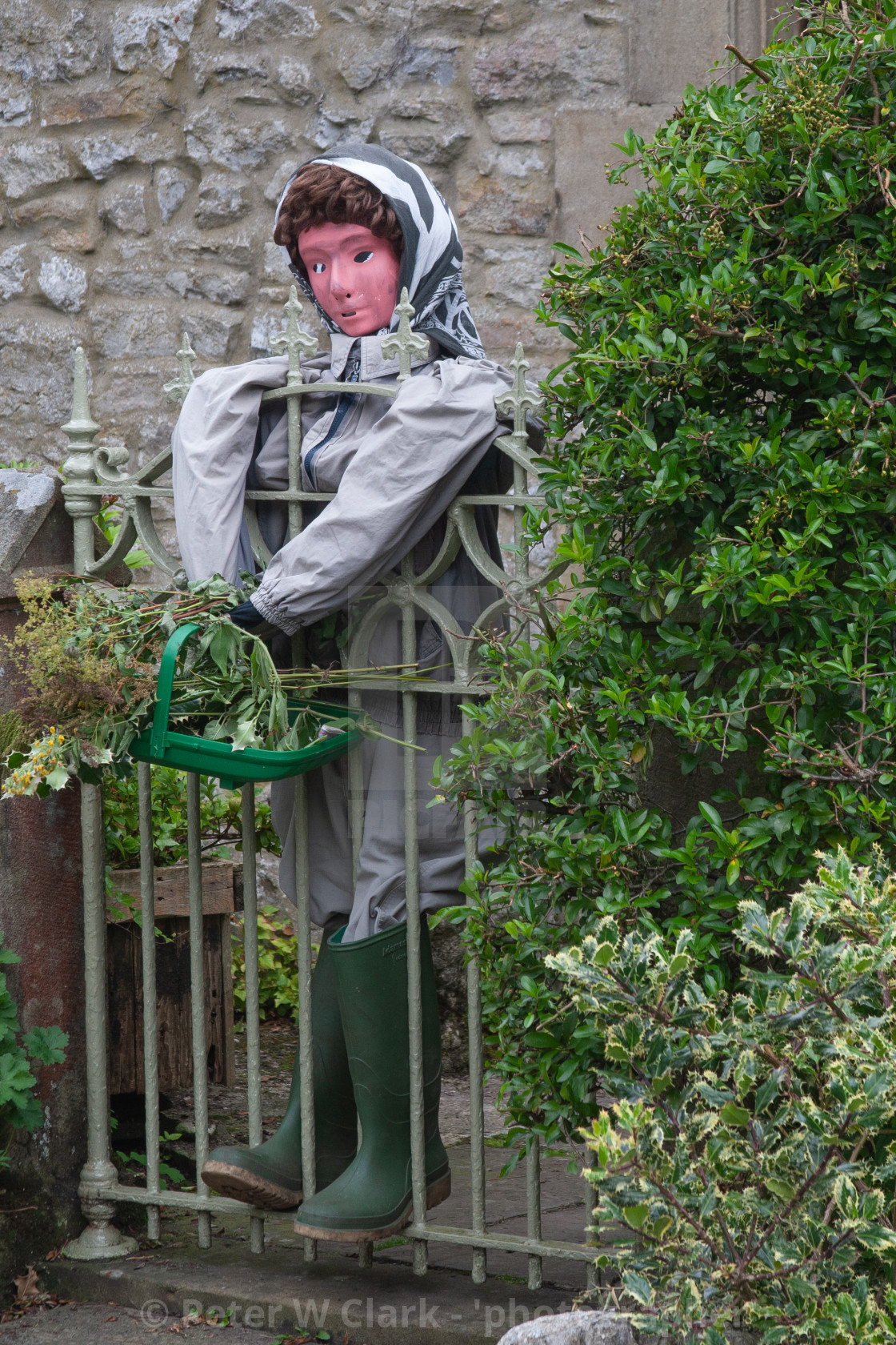 """Kettlewell Scarecrow Festival and Trail, Gardener in Wellingtons. Yorkshire Dales, England."" stock image"