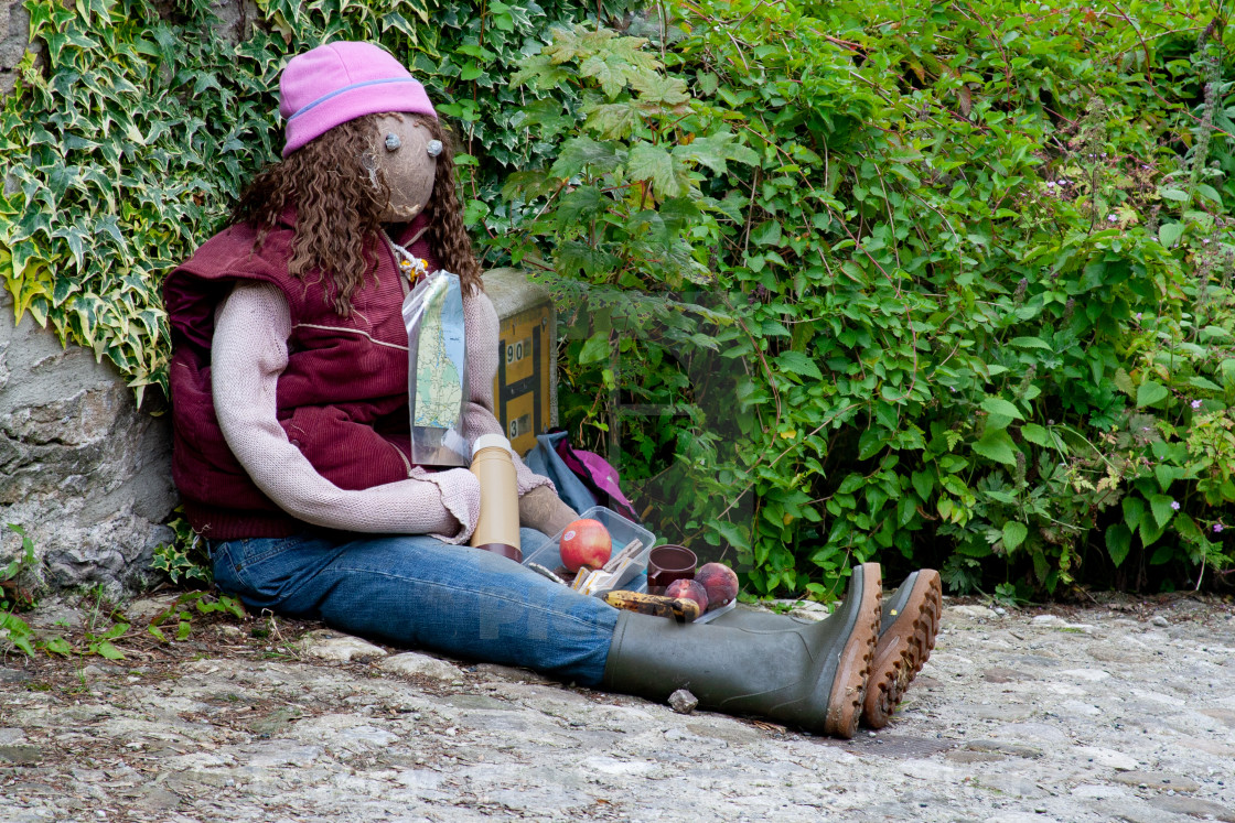 """Kettlewell Scarecrow Festival and Trail, Hiker at Lunchbreak. Yorkshire Dales, England."" stock image"