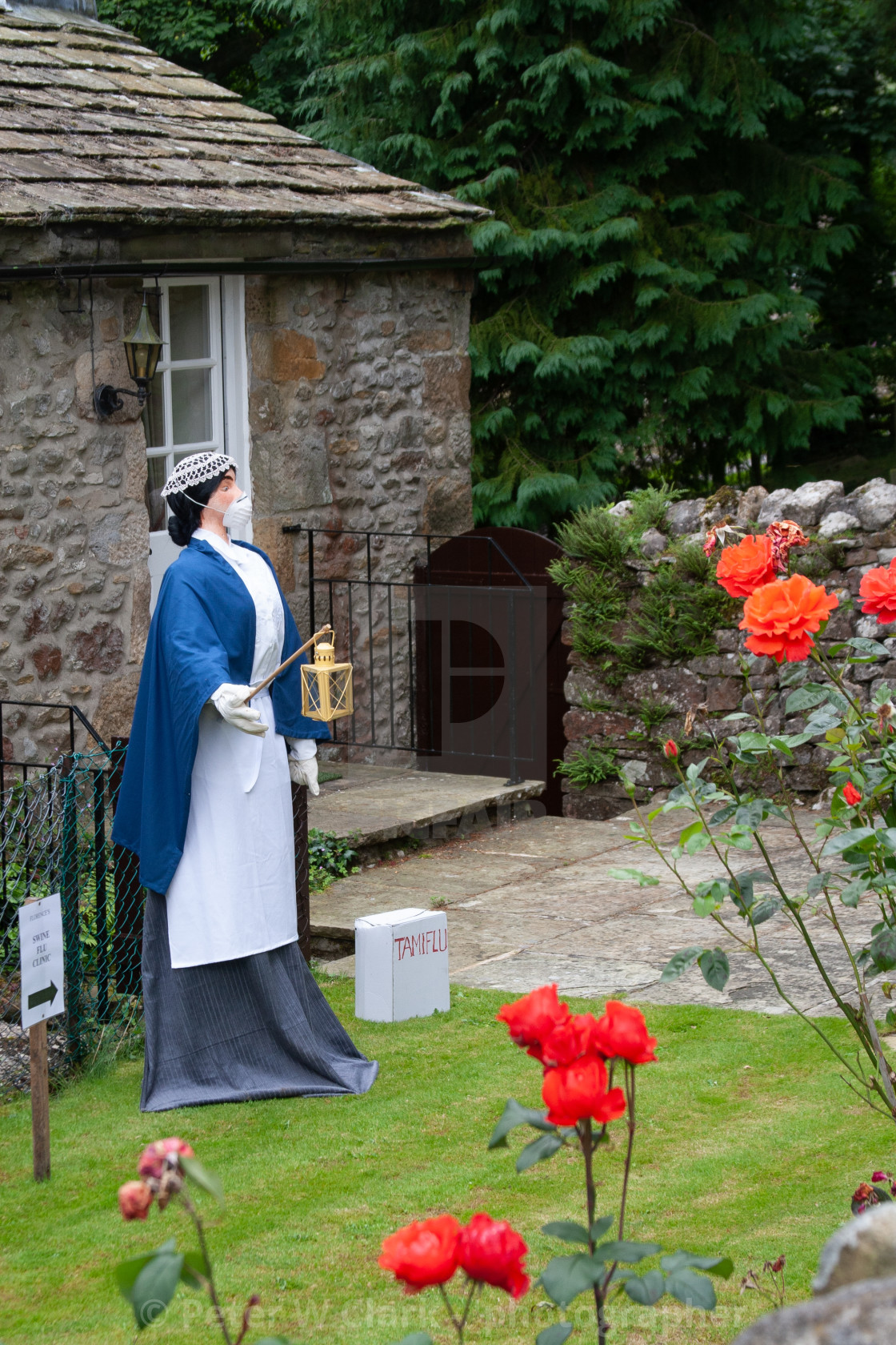 """Kettlewell Scarecrow Festival and Trail, Lady with the Lamp. Yorkshire Dales, England."" stock image"