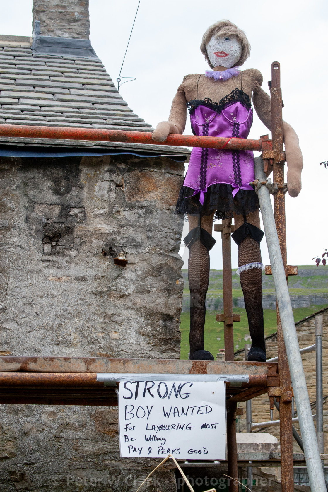 """Kettlewell Scarecrow Festival and Trail, Lady Builder on Scaffolding. Yorkshire Dales, England."" stock image"