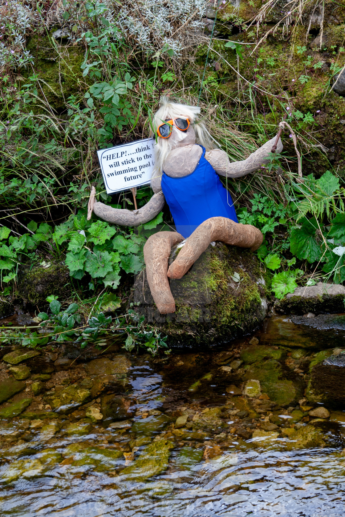"""Kettlewell Scarecrow Festival and Trail, Lost Swimmer. Yorkshire Dales, England."" stock image"