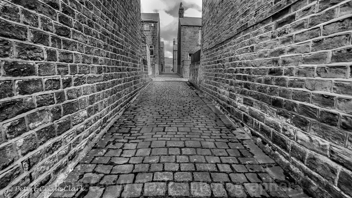 """Stone Cobbles in Passage. Silsden, Cobbydale, Yorkshire, England. Photographed 18th February 2021. Monochrome."" stock image"