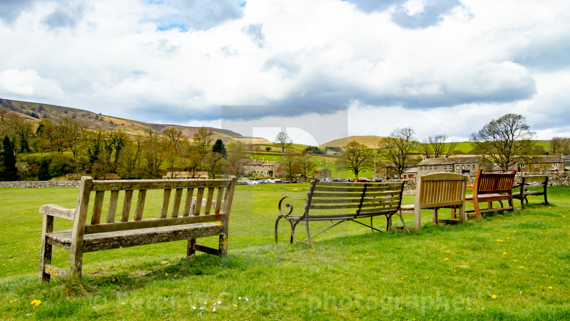 """""""Seats overlooking Burnsall Village Green in Yorkshire Dales."""" stock image"""