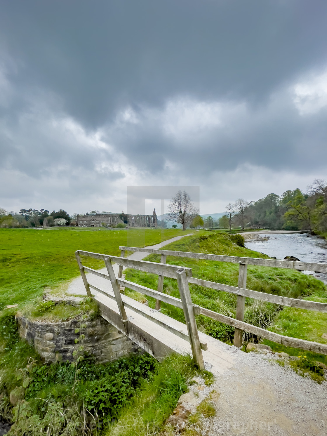 """""""River Wharfe with Footbridge to Bolton Abbey Ruins, Yorkshire,"""" stock image"""