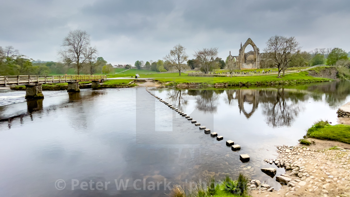 """""""River Wharfe Footbridge and Stepping Stones at Bolton Abbey, Yorkshire Dales."""" stock image"""