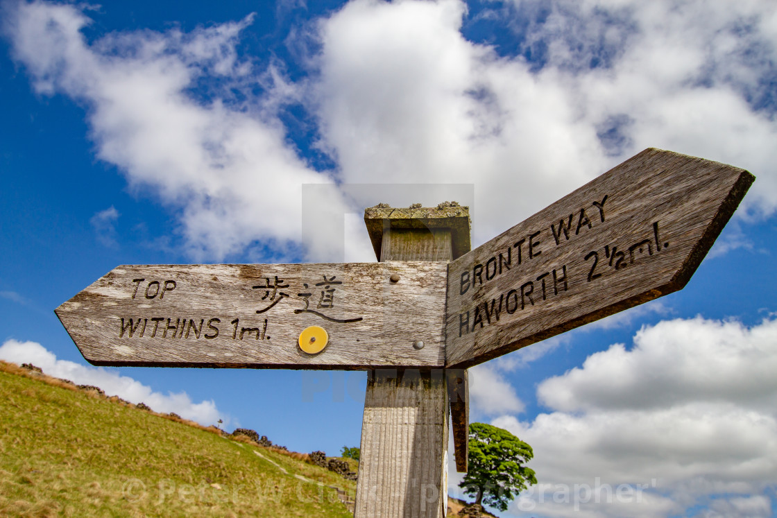 """""""Bronte Country, Signpost for Footpath to Top Withens, a Derelict Farmhouse,"""" stock image"""