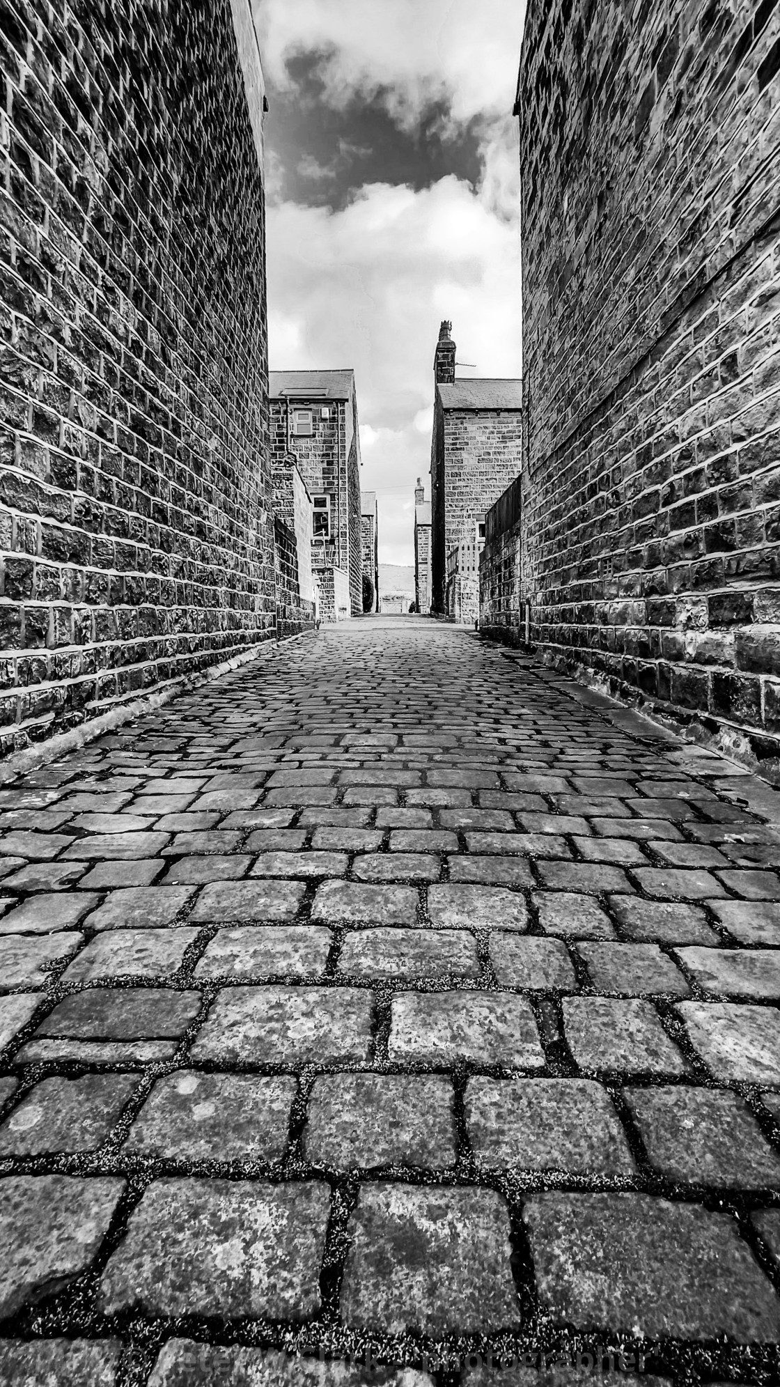 """""""Stone Setts in Passage. Silsden, Cobbydale, Yorkshire, England. Photographed 18th February 2021. Monochrome."""" stock image"""