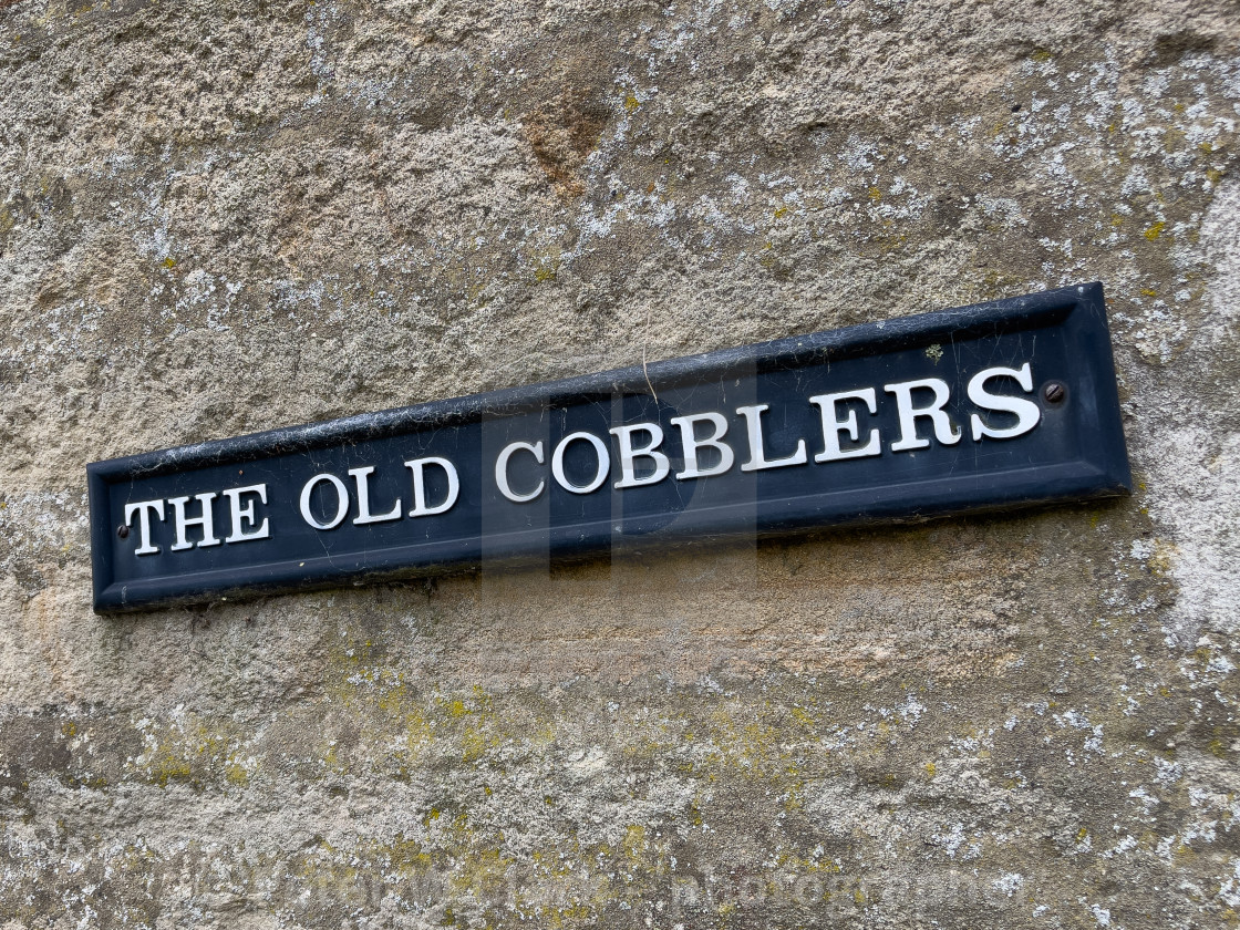 """""""The Old Cobblers, Sign on Stone Wall in Yorkshire Dales."""" stock image"""