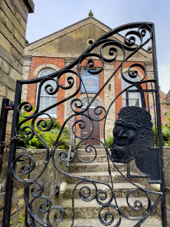 """Richmond Operatic Society Entrance Gate, Yorkshire."" stock image"