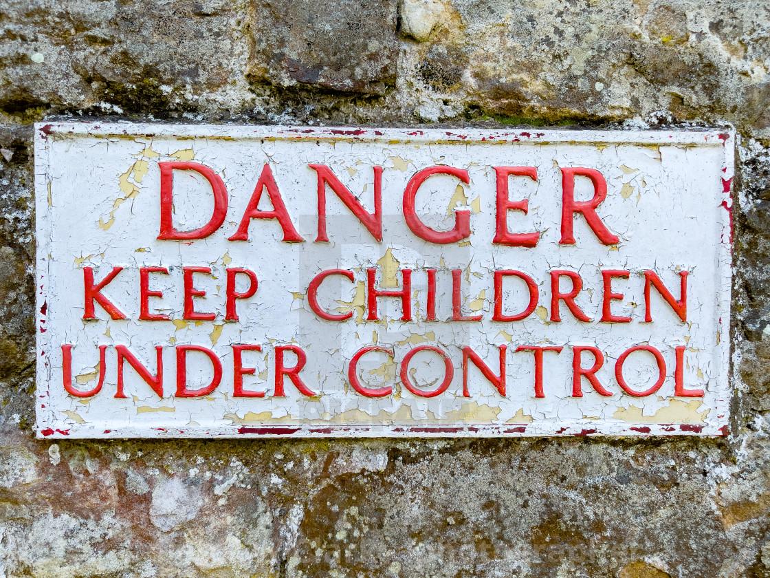 """Danger Warning Sign, keep children under control."" stock image"