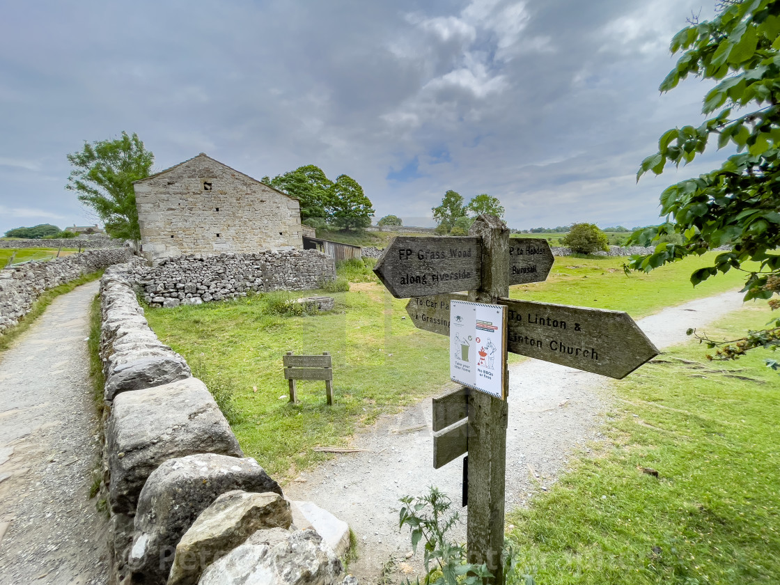 """""""Footpath Signpost, Grassington to Linton in Craven."""" stock image"""