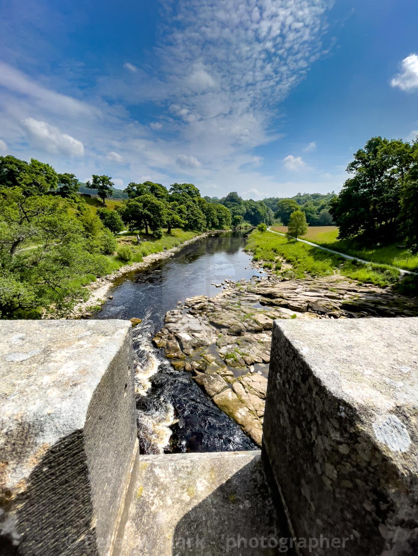 """Crenelated Nidd Aquaduct crossing River Wharfe near Barden Bridge."" stock image"