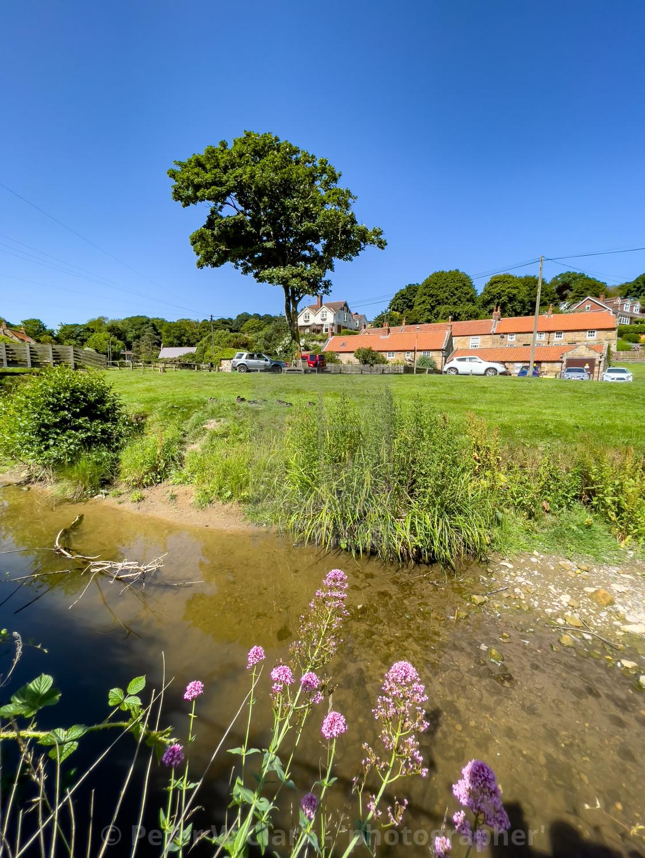 """Sandsend Beck and Cottages."" stock image"