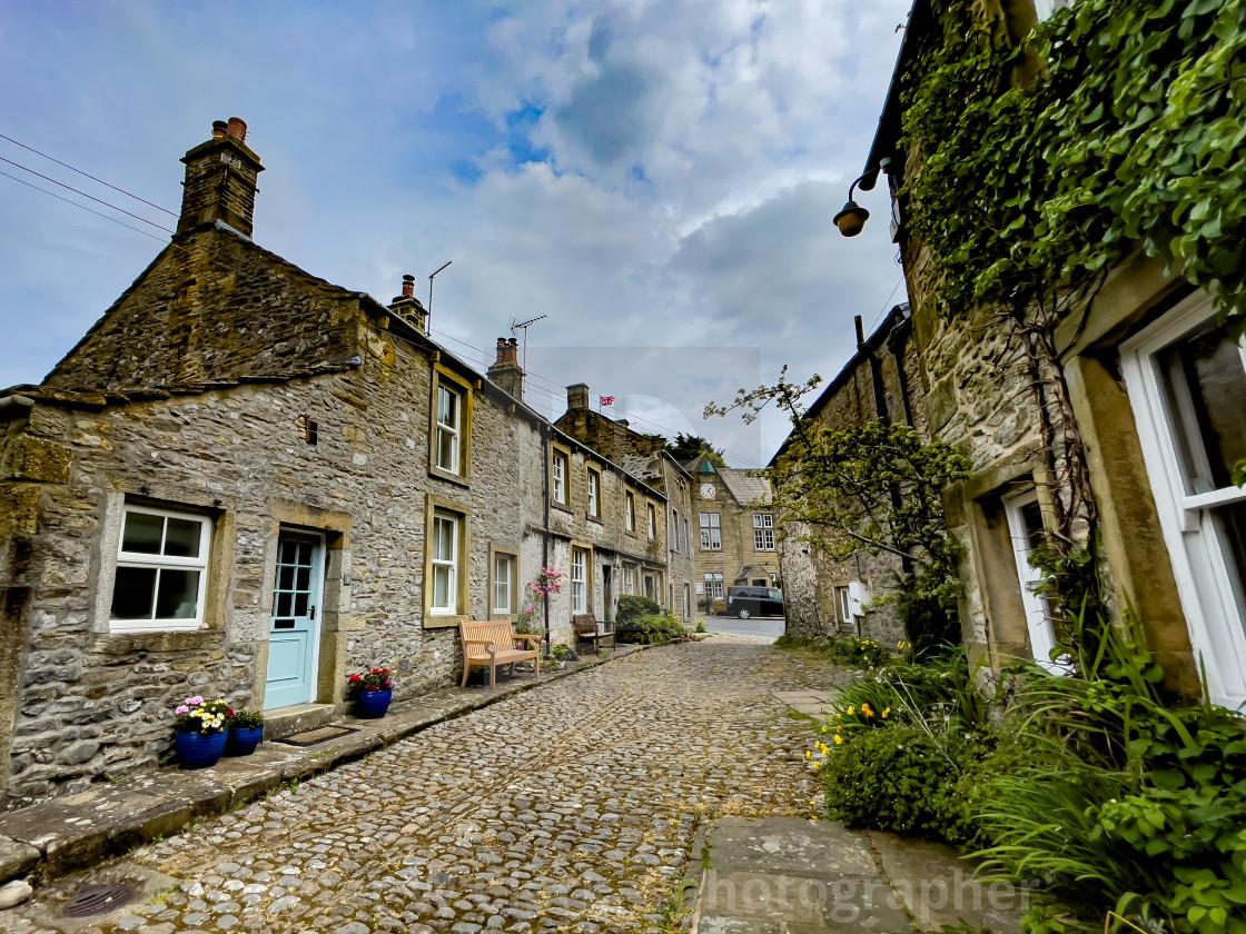 """Grassington, Yorkshire Dales. Cobbled Street."" stock image"