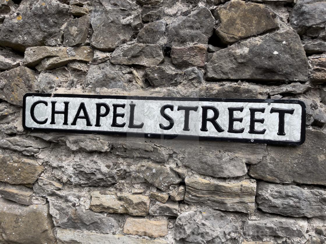 """Grassington, Chapel Street Sign on Stone Background."" stock image"
