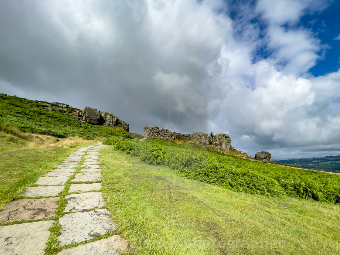 """""""Cow and Calf Rocks, Ilkley. Stone Flagged Pathway."""" stock image"""