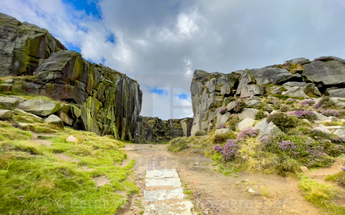"""""""Cow and Calf Rocks, Ilkley. Stone Flagged Pathway to Quarry."""" stock image"""