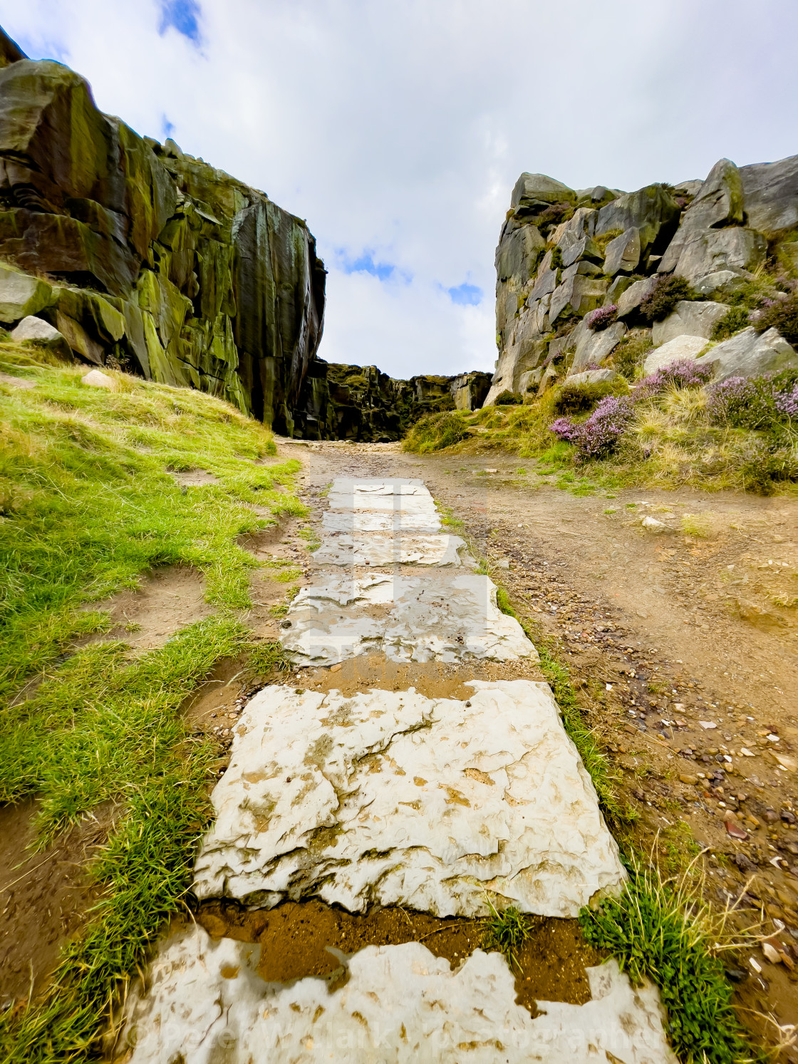 """""""Cow and Calf Rocks, Hangingstone Quarry, Ilkley. Stone Flagged Pathway."""" stock image"""
