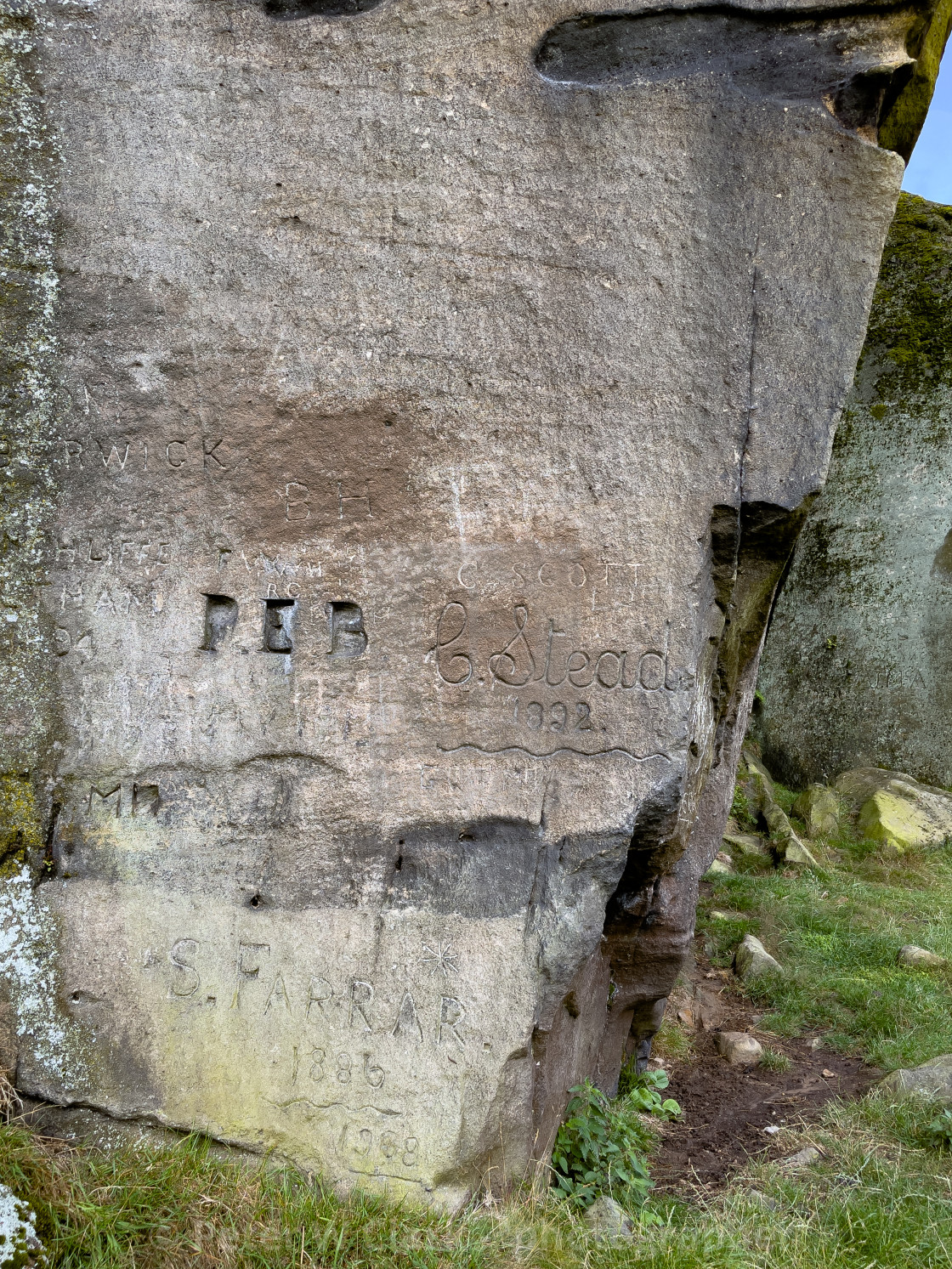 """""""Cow and Calf Rocks, Name Carving, Ilkley."""" stock image"""