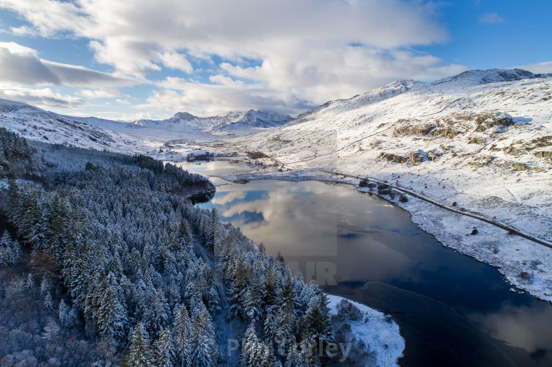 """Snow covered Snowdon over Llynnau Mymbyr"" stock image"