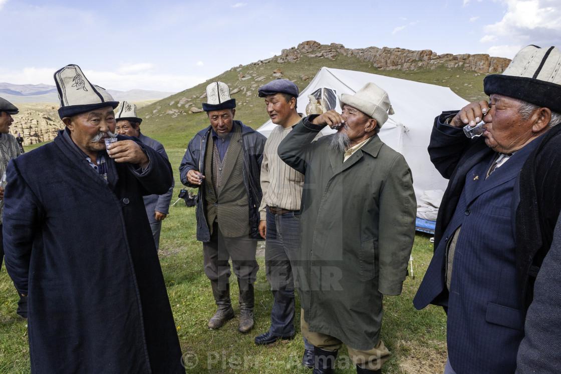 """Men drinkin vodka at celebration"" stock image"