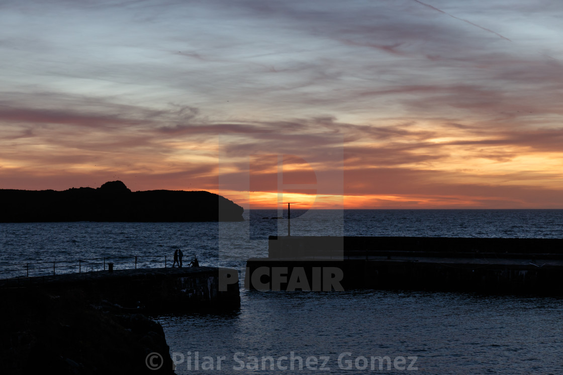 """Sunset at Mullion Cove harbour, Cornwall"" stock image"