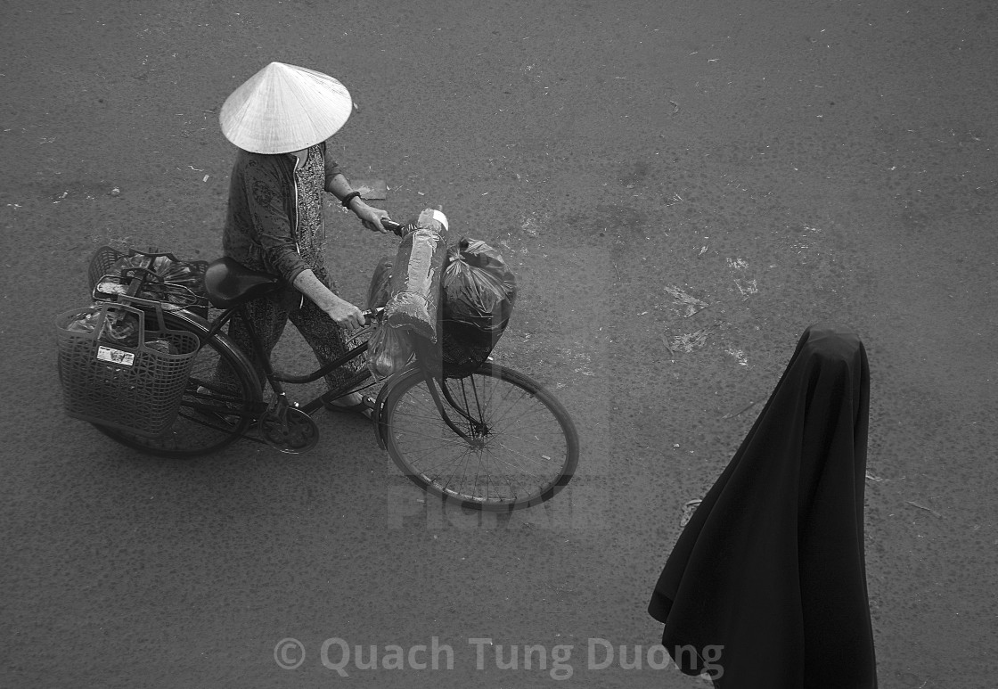 """""""A Vietnamese woman go to the market."""" stock image"""
