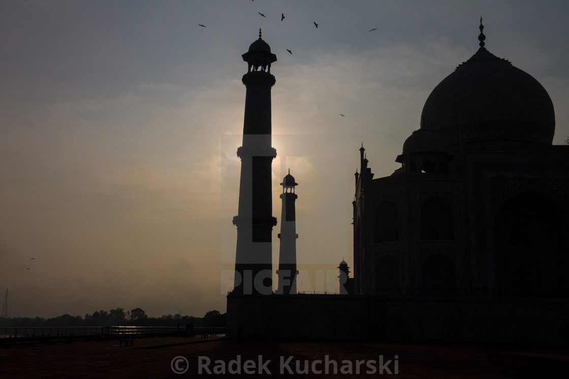 """Taj Mahal and its two minarets shortly after sunrise"" stock image"