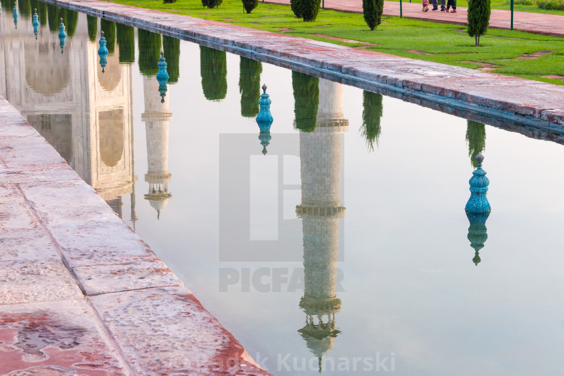 """Minarets of the Taj Mahal reflected in the garden's pool"" stock image"