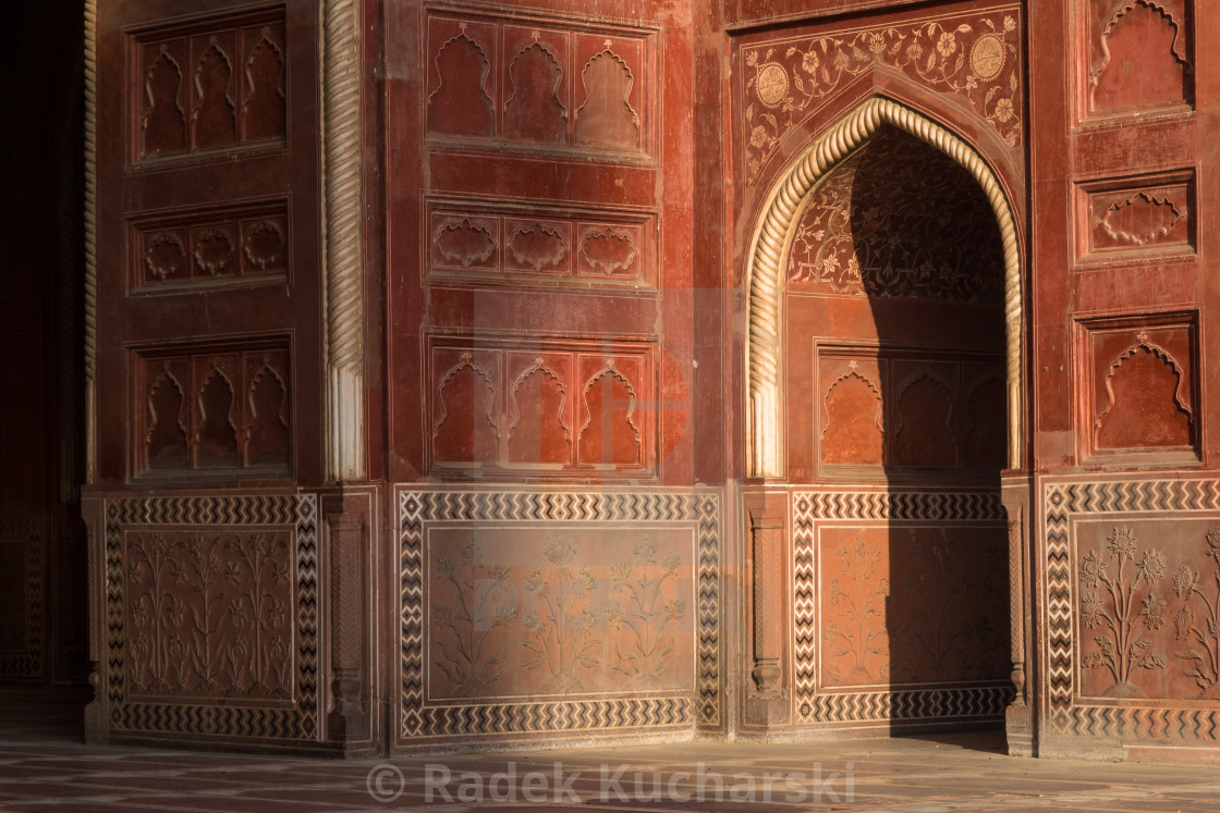 """Doorway in Taj Mahal complex mosque lit by the early-morning sun"" stock image"