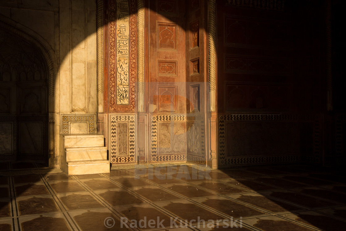 """Mosque at Taj Mahal lit by the rising sun - detailed decoration"" stock image"