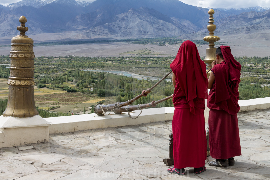 """Thikse Monastery monks playing dungchens (Tibetan horns)"" stock image"
