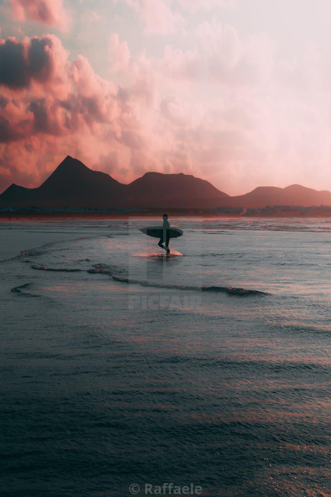 """Surfers in Famara"" stock image"