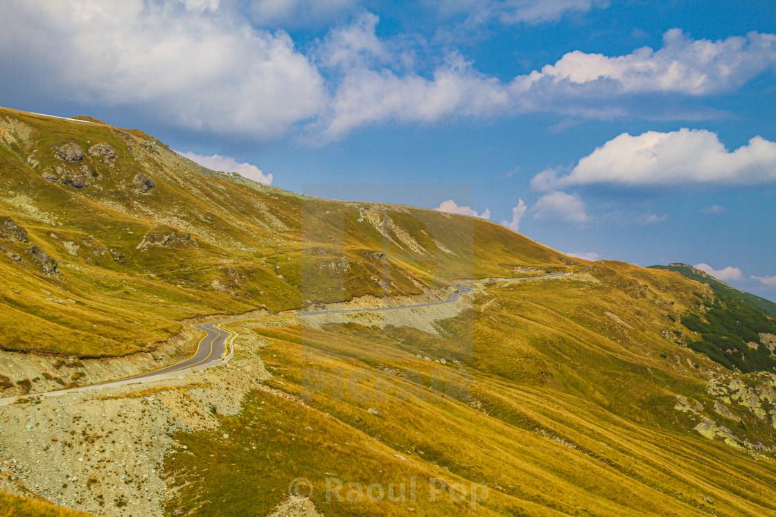 """An alpine road"" stock image"