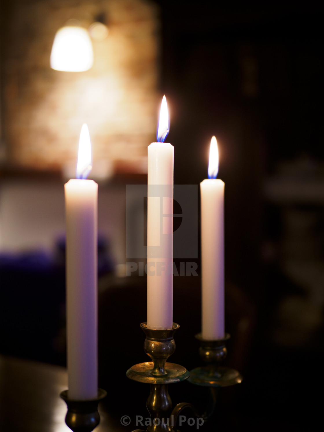 """""""Three candles and a sconce"""" stock image"""