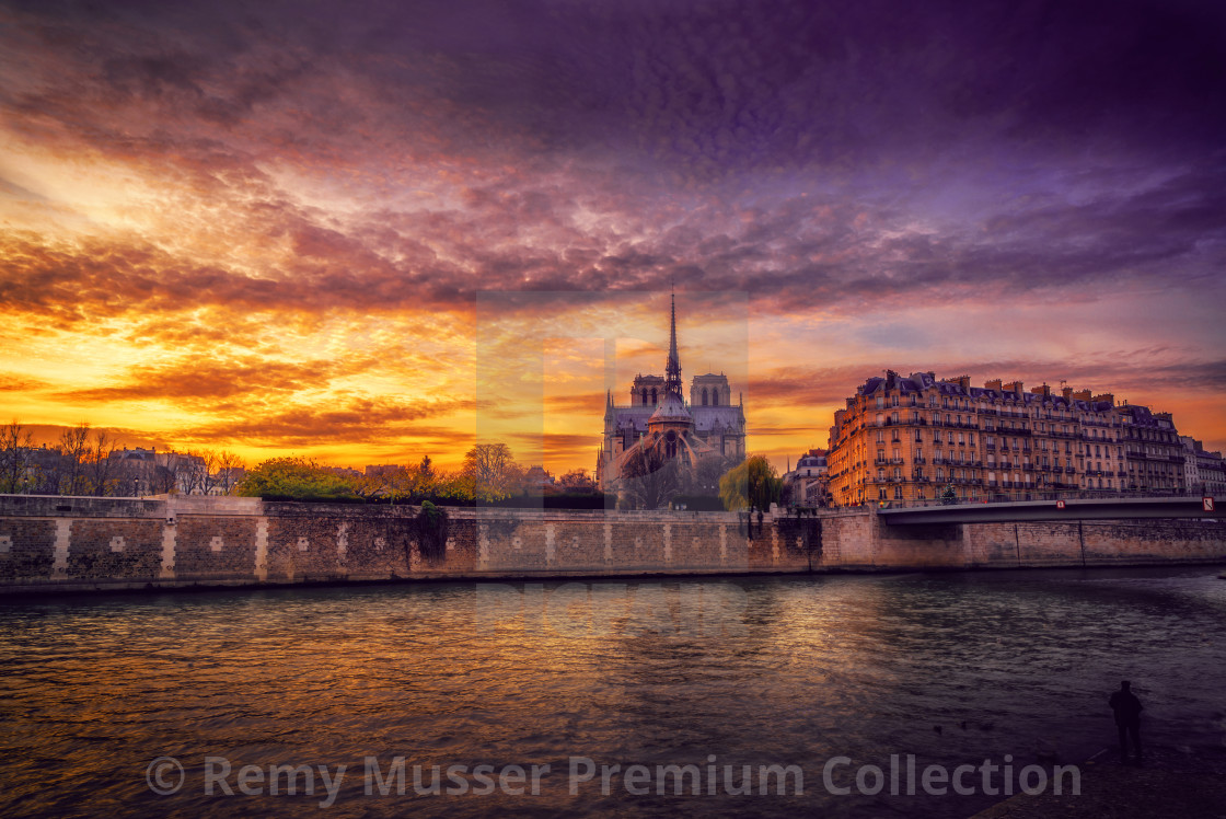 """""""Notre Dame Cathedral with Paris cityscape at dusk"""" stock image"""